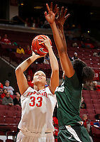 Ohio State Buckeyes center Ashley Adams (33) goes up for a shot against Michigan State Spartans guard Klarissa Bell (21) during the first half of their NCAA basketball game at Value City Arena in Columbus, Ohio on January 26, 2014.  (Dispatch photo by Kyle Robertson)
