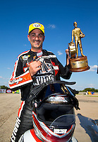Sep 20, 2014; Ennis, TX, USA; NHRA pro stock motorcycle rider Eddie Krawiec celebrates after winning the rescheduled Carolina Nationals as a part of qualifying for the Fall Nationals at the Texas Motorplex. The race was originally scheduled at zMax Dragway in Concord, NC but was moved due to track conditions. Mandatory Credit: Mark J. Rebilas-USA TODAY Sports
