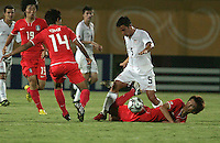 The United States' Danny Cruz (5) controls the ball over the body of a South Korea player during the FIFA Under 20 World Cup Group C match between the United States and South Korea at the Mubarak Stadium on October 02, 2009 in Suez, Egypt. The US team lost 3-0.