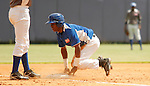 """Major League Baseball prospect Roberto Caro slides in safely during the final game of the """"Torneo Supremo"""" at the Quiskeya National Stadium in Santo Domingo. The Tournament which aims to maximize the ability of Major League Baseball organizations to scout in the Dominican Republic. According to the MLB's office in the Dominican Republic, this year, the tournament introduced 23 new baseball prospects. July 29 2011. ViewPress/ Kena Betancur"""