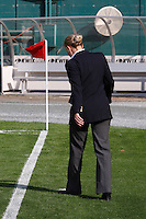 An assistant referee inspects the sidelines before the match. The women's national team of the United States defeated Canada 6-0 during an international friendly at Robert F. Kennedy Memorial Stadium in Washington, D. C., on May 10, 2008.