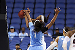 27 March 2015: North Carolina's Stephanie Mavunga (1) blocks a shot by South Carolina's Alaina Coates (behind). The University of North Carolina Tar Heels played the University of South Carolina Gamecocks at the Greensboro Coliseum in Greensboro, North Carolina in a 2014-15 NCAA Division I Women's Basketball Tournament regional semifinal game. South Carolina won the game 67-65.