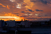 Brooklyn, New York<br /> August 28, 2011<br /> <br /> The Manhattan skyline as the hurricane/tropical storm Irene sunset from Park Slope Brooklyn.<br /> <br /> Irene fades to the north and history leaving New  York City in tact.