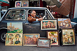 00472_20, Rome, Italy, 1984,  ITALY-10041NF. A man displays paintings while he reads in his car.<br /> <br /> Retouched_Sonny Fabbri 04/28/2014