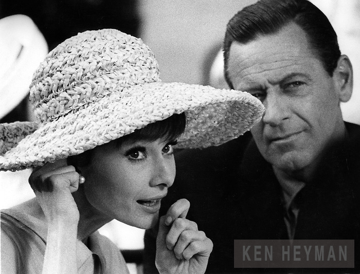 Audrey Hepburn on the movie set with Bill Holden.
