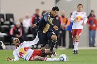 Michael Orozco (16) of the Philadelphia Union gets past a fallen Juan Agudelo (39) of the New York Red Bulls. The New York Red Bulls defeated the Philadelphia Union 2-1 during a US Open Cup qualifier at Red Bull Arena in Harrison, NJ, on April 27, 2010.