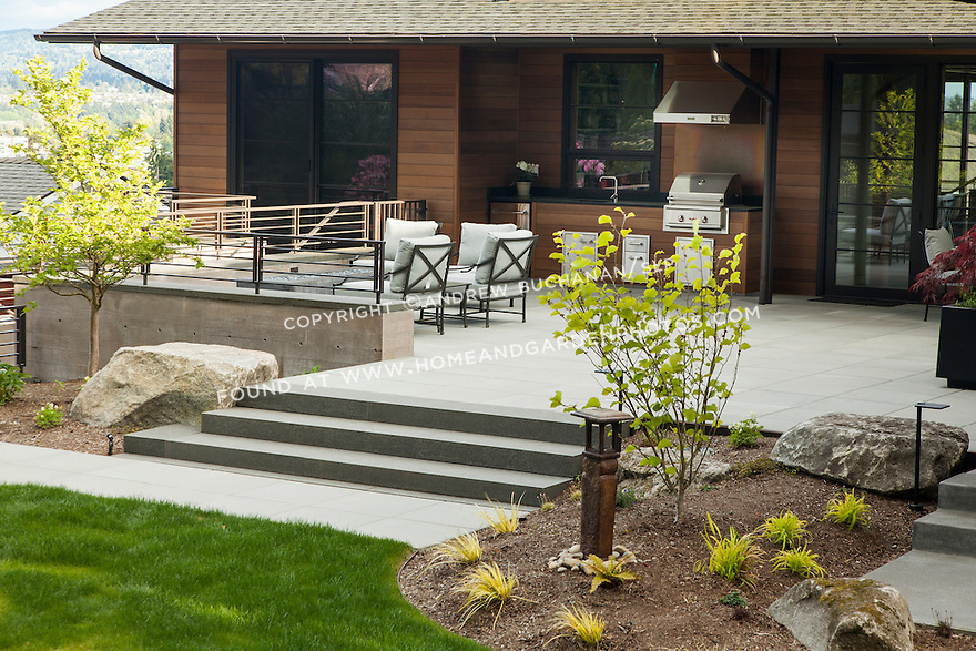Patio area with outdoor seating and grill