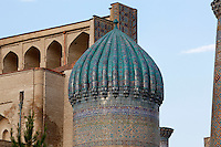 """Detail of dome, Sher-Dor Madrasah, 1619-36, Registan, Samarkand, Uzbekistan, pictured on July 16, 2010, at dawn. The Sher-Dor Madrasah, commissioned by Yalangtush Bakhodur as part of the Registan ensemble, and designed by Abdujabor, takes its name, """"Having Tigers"""", from the double mosaic (restored in the 20th century) on the tympans of the portal arch showing suns and tigers attacking deer. Samarkand, a city on the Silk Road, founded as Afrosiab in the 7th century BC, is a meeting point for the world's cultures. Its most important development was in the Timurid period, 14th to 15th centuries. Picture by Manuel Cohen."""