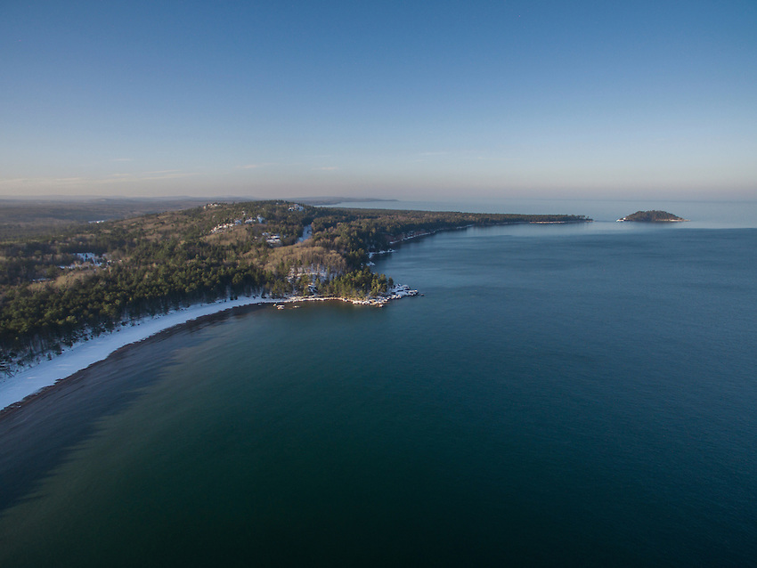 Aerial view of Lake Superior shoreline and Little Presque Isle near Marquette, Michigan.
