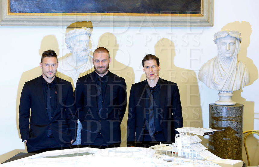 Da sinistra, il capitano Francesco Totti, il centrocampista Daniele De Rossi e l'allenatore Rudi Garcia alla presentazione del progetto del nuovo Stadio della Roma, in Campidoglio, Roma, 26 marzo 2014.<br /> From left, AS Roma captain Francesco Totti, midfielder Daniele De Rossi and Rudi Garcia, of France, at the presentation of the project of the AS Roma football club's new stadium at the Capitol Hill, Rome, 26 March 2014.<br /> UPDATE IMAGES PRESS/Riccardo De Luca