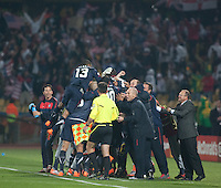 Clint Dempsey (8) celebrates with his teammates after scoring a goal in the first half of the 2010 World Cup match between USA and England in Rustenberg, South Africa on Saturday, June 12, 2010.