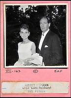BNPS.co.uk (01202 558833)<br /> Pic: DominicWinter/BNPS<br /> <br /> Audrey Hepburn with then husband Mel Ferrer.<br /> <br /> A remarkable set of 430 candid photographs of Hollywood royalty have been unearthed after 50 years.<br /> <br /> Included in the collection of unpublished pictures are snaps of silver screen icons Paul Newman, Charlie Chaplin, Bette Davis, Audrey Hepburn, and Dean Martin.<br /> <br /> Paul Newman is captured looking over his shoulder at the wheel of his car and Charlie Chaplin is pictured without his trademark moustache. <br /> <br /> Audrey Hepburn has posed with her then husband actor Mel Ferrer while Bette Davis can be seen puffing on a cigarette.<br /> <br /> The snaps were taken by obsessive amateur photographer Dwight 'Dodo' Romero from 1954 to 1967 who would hang around at Hollywood parking lots and other hang-outs to catch a glimpse of the stars.<br /> <br /> The photos, which more recently belonged to a book dealership in York, have emerged for auction and are tipped to sell for &pound;800.