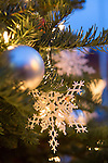 Decorations sparkle on a Christmas tree tree located at First and Main Streets in preparation for the holidays.