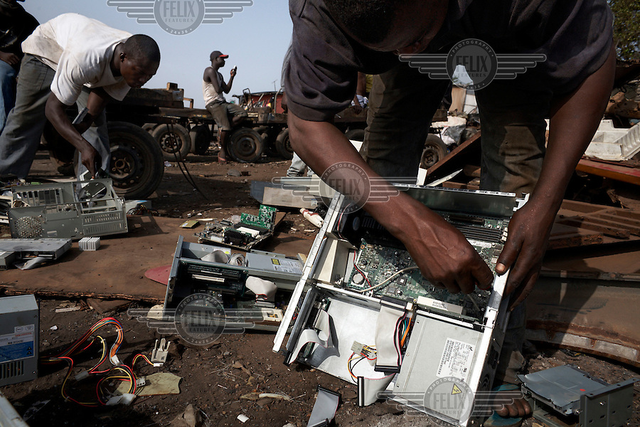Computer hard drives are dismantled at Agbogbloshie dump, which has become a dumping ground for computers and electronic waste from all over the developed world. Hundreds of tons of e-waste end up here every month. It is broken apart, and those components that can be sold on, are salvaged.