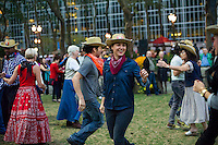 Hundreds of New Yorkers and visitors dance up a storm in Bryant Park in New York on Wednesday, September 25, 2013 during the third and last square dancing session of the year in the park. As incongruous as it sounds square dancing's popularity in New York ebbs and flows with it reaching its peak after World War II where thousands would participate in large dances held in Central Park. (© Frances M. Roberts)Hundreds of New Yorkers and visitors dance up a storm in Bryant Park in New York on Wednesday, September 25, 2013 during the third and last square dancing session of the year in the park. As incongruous as it sounds square dancing's popularity in New York ebbs and flows with it reaching its peak after World War II where thousands would participate in large dances held in Central Park. (© Frances M. Roberts)