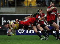Tom Marshall tackles Aaron Cruden. Super 15 rugby match - Crusaders v Hurricanes at Westpac Stadium, Wellington, New Zealand on Saturday, 18 June 2011. Photo: Dave Lintott / lintottphoto.co.nz