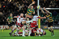 Willi Heinz of Gloucester Rugby box-kicks the ball as Sam Dickinson and Christian Day of Northampton Saints look to charge him down. Aviva Premiership match, between Northampton Saints and Gloucester Rugby on November 27, 2015 at Franklin's Gardens in Northampton, England. Photo by: Patrick Khachfe / JMP