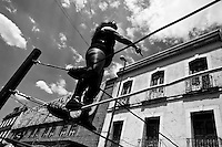 """A female Lucha libre wrestler La Fugitiva stands on the ropes to throw herself into the ring during a fight at a local arena in Mexico City, Mexico, 30 April 2011. Lucha libre, literally """"free fight"""" in Spanish, is a unique Mexican sporting event and cultural phenomenon. Based on aerial acrobatics, rapid holds and the use of mysterious masks, Lucha libre features the wrestlers as fictional characters (Good vs. Evil). Women wrestlers, known as luchadoras, often wear bright shiny leotards, black pantyhose or other provocative costumes. Given the popularity of Lucha libre in Mexico, many wrestlers have reached the cult status, showing up in movies or TV shows. However, almost all female fighters are amateur part-time wrestlers or housewives. Passing through the dirty remote areas in the peripheries, listening to the obscene screams from the mainly male audience, these no-name luchadoras fight straight on the street and charge about 10 US dollars for a show. Still, most of the young luchadoras train hard and wrestle virtually anywhere dreaming to escape from the poverty and to become a star worshipped by the modern Mexican society."""