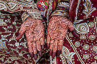 Braide & groom getting married with henna, Varanasi, Uttar Pradesh, India