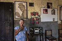 Nicaragua. After her husband died this woman continued the profession he taught her, making masks.