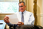 08/01/2011 - Medford/Somerville, Mass. Tufts University President Anthony Monaco reads a hand-written letter from his predecessor, Lawrence S. Bacow, on Monday, August 1, 2011, his first day in office.   (Alonso Nichols/Tufts University).