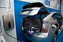 May 131, 2012, Tokyo, Japan - A electric car charging. The Smart Grid Exhibition and Automotive Next Industry Fair 2012 shows the next generation of vehicles and manufacturing working with eco energy, from May 30th. to June 1st. at Tokyo Big Site.