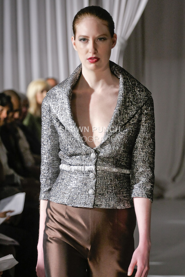 Model walks runway in an outfit from the b Michael AMERICA Couture Fall 2012 collection by b Michael, during Mercedes-Benz Fashion Week New York, Fall 2012.