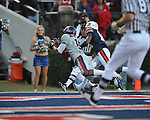 Ole Miss wide receiver Markeith Summers (16) catches a touchdown pass as Auburn defensive back Demond Washington (14) defends at Vaught-Hemingway Stadium in Oxford, Miss. on Saturday, October 30, 2010. Auburn won 51-31.