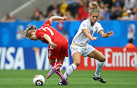 USA's Kristie Mewis (R) and Lara Keller of Switzerland during the FIFA U20 Women's World Cup at the Rudolf Harbig Stadium in Dresden, Germany on July 17th, 2010.