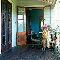 View looking into a four-poster bedroom from the verandah which surrounds the house
