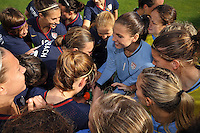 US Women's National Team huddles around Hope Solo before a game at the Algarve Cup in Portugal's VIla Real Sto. Antonio stadium.