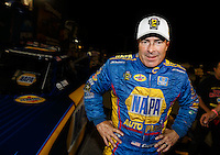 Nov 12, 2016; Pomona, CA, USA; NHRA funny car driver Ron Capps celebrates after clinching the 2016 funny car world championship during qualifying for the Auto Club Finals at Auto Club Raceway at Pomona. Mandatory Credit: Mark J. Rebilas-USA TODAY Sports