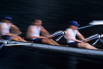 Eight man crew rowing along Montlake Cut near the University of Washington sunrise motion panning Seattle Washington State USA