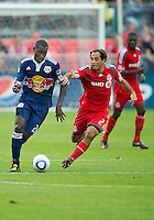 21 August 2010: New York Red Bulls midfielder Tony Tchani #23 and Toronto FC midfielder Nick LaBrocca #21 in action during a game between the New York Red Bulls and Toronto FC at BMO Field in Toronto..The New York Red Bulls won 4-1.