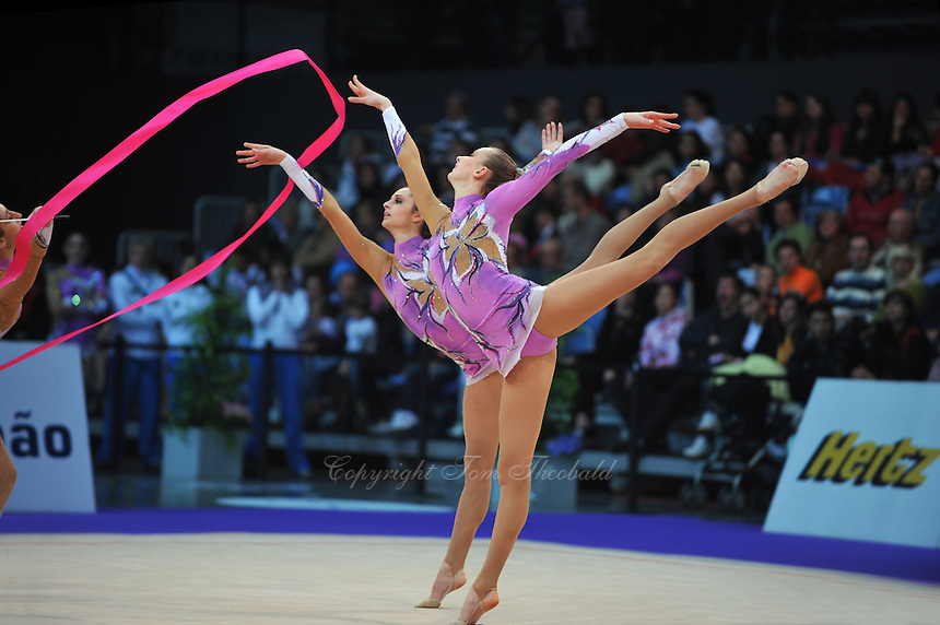 (Foreground-behind) Anzhelika Savrayuk and Daniela Masseroni of rhythmic group from Italy performs in ribbon + rope Event Final at 2010 World Cup at Portimao, Portugal on March 14, 2010.  (Photo by Tom Theobald).