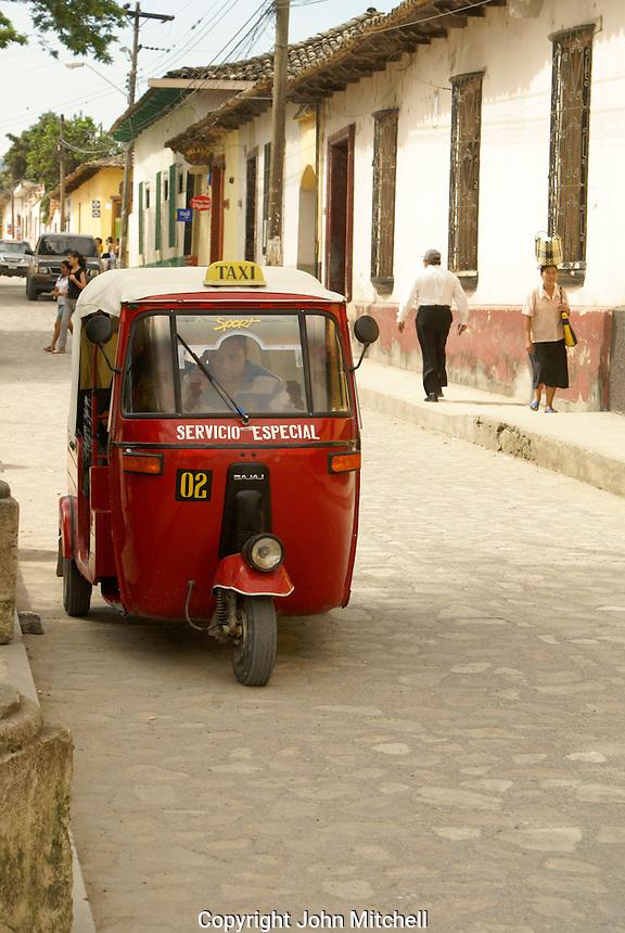 Tuk tuk on a street in the Spanish colonial town of Gracias, Lempira, Honduras...
