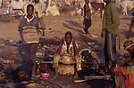Africa, Nigeria, Kano State, Kano. Boys work in the abattoir and markets. Every part of the slaughtered beasts is recovered and used. 2003.'MEAT' across the World..foto © Nigel Dickinson
