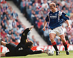 Gordon Durie takes the ball around Gilles Rousset in the Hearts goal