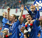 Barry Ferguson and Craig Moore with their kids after Rangers win the SPL on goal difference from Celtic
