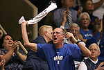 06 February 2012: A Duke fan leads the other fans in a cheer. The Duke University Blue Devils defeated the University of North Carolina Tar Heels 96-56 at Cameron Indoor Stadium in Durham, North Carolina in an NCAA Division I Women's basketball game.