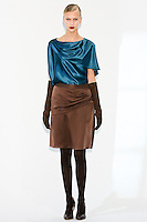 Model wears an asymmetric lapel jacket, and asymmetic skirt, by Fiona Cibani, for the Ports 1961 Pre-Fall 2011 L'heure bleue collection, December 8, 2010.