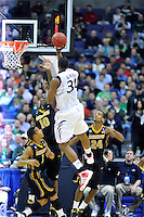 Yancy Gates of the Bearcats puts up a one-handed shot. Cincinnati defeated Missouri 78-63 during the NCAA tournament at the Verizon Center in Washington, D.C. on Thursday, March 17, 2011. Alan P. Santos/DC Sports Box