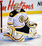 24 September 2009: Boston Bruins' goaltender Tim Thomas warms up prior to facing the Montreal Canadiens at the Bell Centre in Montreal, Quebec, Canada. The Bruins defeated the Canadiens 2-1 in an overtime shootout. Mandatory Photo Credit: Ed Wolfstein Photo