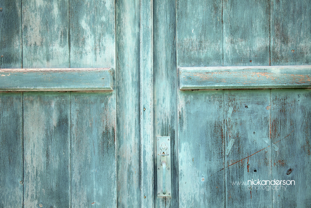 Old doors, weathered but given a fresh yet light coat of paint not too long ago, in Omodos, a well preserved village in the Troodos mountains of Cyprus (Nick Anderson)
