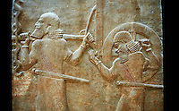 Stone relief sculptured panel of soldiers carrying a war chariot . Facade L. Inv AO 19884 from Dur Sharrukin the palace of Assyrian king Sargon II at Khorsabad, 713-706 BC.  Louvre Museum Room 4 , Paris