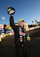 Feb 8, 2015; Pomona, CA, USA; NHRA pro stock driver Jason Line celebrates after winning the Winternationals at Auto Club Raceway at Pomona. Mandatory Credit: Mark J. Rebilas-
