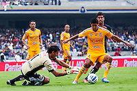 Tigres player Hugo Ayala (4) protects the ball for his goalkeeper Nahuel Guzmán (1) as Eduardo Herrera (15) of Pumas fights for the ball during their match between Pumas VS Tigres both teams were tied at two goals. Photo by Miguel Angel Pantaleon/VIEWpress
