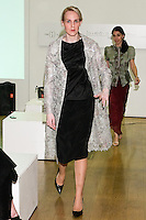 85 Broads member walks runway in a SS11 Spanish beaded lace coat, FW silk jersey top, and SS11 skirt by Yuna Yang, during the 85 Broads Presents Yuna Yang trunk show at Art Gate Gallery on October 24th 2011.