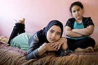 Cousins Noor (Left) and Shayma in a house rented by a Kuwati businessman on behalf of Syrian widows and their children. They are both 11 years old and come from the Syrian city of Deraa.