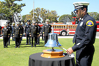 Santa Monica Fire Captain Sean Vansluis rings  the bell ten times during the Police/Fire Public Safety Memorial at City Hall on Thursday, May 12, 2011. The memorial recognized public safety officers who gave their lives in the line of duty to protect the citizens of Santa Monica...